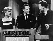 "Author photo. Quiz show ""21"" host Jack Barry turns toward contestant Charles Van Doren as fellow contestant Vivienne Nearing looks on/photo by Orlando Fernandez: New York World-Telegram and the Sun Newspaper Photograph Collection (Library of Congress)(LC-USZ62-126813)"