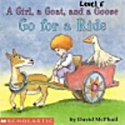 A girl, a goat, and a goose go for a ride by…