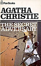 cover art for The Secret Adversary by Agatha Christie, featuring a pair of scissors laid across the back of a partially-dismantled picture frame