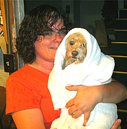 Author photo. Me with one of my dogs, Lily. I'd just given her a bath, and she wasn't too happy!