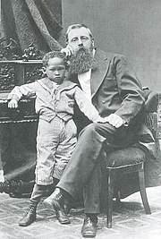 Author photo. Gustaf De Vylder with Joseph, his adopted Bushman child.