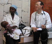 """Author photo. Paul Farmer- with-mom-and-baby---Quy-Ton-12-2003 1-1-310 By User:Cjmadson - <a href=""""//en.wikipedia.org/wiki/File:PEF-with-mom-and-baby---Quy-Ton-12-2003_1-1-310.jpg"""" rel=""""nofollow"""" target=""""_top"""">https://en.wikipedia.org/wiki/File:PEF-with-mom-and-baby---Quy-Ton-12-2003_1-1-3...</a>, CC BY 3.0, <a href=""""//commons.wikimedia.org/w/index.php?curid=32838166"""" rel=""""nofollow"""" target=""""_top"""">https://commons.wikimedia.org/w/index.php?curid=32838166</a>"""