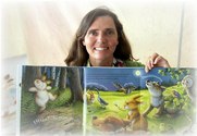 "Author photo. Lisa McCue, author/illustrator, holding ""Quiet Bunny."" 2009 Baltimore Book Festival. ©2009."