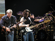 "Author photo. <a href=""http://en.wikipedia.org/wiki/File:Rush-in-concert.jpg"" rel=""nofollow"" target=""_top"">Canadian rock band Rush, in concert in Milan, Italy.</a>"