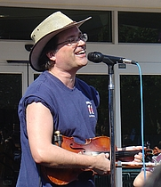 Author photo. Lead singer Gordon Gano, concert at UCSD, Jan. 31, 2006 (photo credit: wikipedia user CharlesCA)