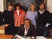 Author photo. Stig Anderson (seated) with ABBA