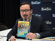 "Author photo. John Hodgman at BookExpo at the Javits Center in New York City, May 2019. By Rhododendrites - Own work, CC BY-SA 4.0, <a href=""https://commons.wikimedia.org/w/index.php?curid=79387555"" rel=""nofollow"" target=""_top"">https://commons.wikimedia.org/w/index.php?curid=79387555</a>"