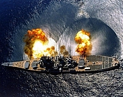 """Author photo. USS Iowa (BB-61) fires a full broadside of nine 16""""/50 and six 5""""/38 guns during a target exercise near Vieques Island, Puerto Rico, 1 July 1984. Photographed by PHAN J. Alan Elliott. (history.navy.mil)"""