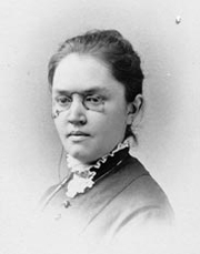 """Author photo. Photographic portrait of Katharine Lee Bates, author of """"America the Beautiful"""". Image believed to be in Public Domain. By RL - Find a Grave [1], Public Domain, <a href=""""//commons.wikimedia.org/w/index.php?curid=5649414"""" rel=""""nofollow"""" target=""""_top"""">https://commons.wikimedia.org/w/index.php?curid=5649414</a>"""