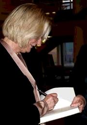 """Author photo. Kirsten Boie signing a copy of """"Der Junge, der Gedanken lesen konnte"""" at the opening night of the 'islands of books', Berlin 2012"""