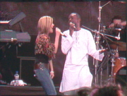 "Author photo. Dido and Youssou N'Dour performing ""Seven Seconds"" at Live 8 in Hyde Park. By The original uploader was Djr xi at English Wikipedia. - Transferred from en.wikipedia to Commons by Jay8g using CommonsHelper., CC BY-SA 3.0, <a href=""https://commons.wikimedia.org/w/index.php?curid=18322786"" rel=""nofollow"" target=""_top"">https://commons.wikimedia.org/w/index.php?curid=18322786</a>"