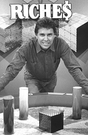 """Author photo. Here we see Steve on the set of Illinois Instant Riches with his """"Knockout"""" game creation. By Steveryangames - photographed on set of TV showPreviously published: <a href=""""http://www.steveryangames.com"""" rel=""""nofollow"""" target=""""_top"""">www.steveryangames.com</a>, CC BY-SA 3.0, <a href=""""https://commons.wikimedia.org/w/index.php?curid=23270811"""" rel=""""nofollow"""" target=""""_top"""">https://commons.wikimedia.org/w/index.php?curid=23270811</a>"""