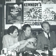 """Author photo. Playwrights Harvey Fierstein, Robert Patrick, and Doric Wilson under posters for their own plays at Phebe's, """"the Sardi's of Off-Off Broadway,"""" 1981. By No machine-readable author provided. Tomalhe~commonswiki assumed (based on copyright claims). - No machine-readable source provided. Own work assumed (based on copyright claims)., Public Domain, <a href=""""https://commons.wikimedia.org/w/index.php?curid=1438514"""" rel=""""nofollow"""" target=""""_top"""">https://commons.wikimedia.org/w/index.php?curid=1438514</a>"""