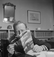 Author photo. A portrait of author Hilary St George Saunders at his flat in Camden Hill, London.