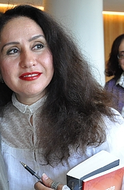 Author photo. By Peripatetic (Original image) - →This file has been extracted from another file: Mohammed Achaari and Rajaa Alem, joint winners of the 2011 Arabic Booker Prize.jpg, <a href=&quot;https://commons.wikimedia.org/w/index.php?curid=42769673&quot; rel=&quot;nofollow&quot; target=&quot;_top&quot;>https://commons.wikimedia.org/w/index.php?curid=42769673</a>
