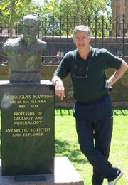 Author photo. Beau Riffenburgh next to a bust of Sir Douglas Mawson at the University of Adelaide, South Australia, AU