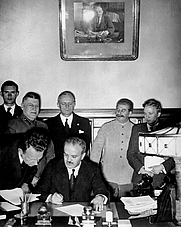 Author photo. Moscow, August 23, 1939: Molotov signs the German–Soviet non-aggression pact as Ribbentrop and Stalin look on.