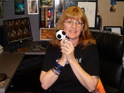 Author photo. Adrian Phoenix with her mascot, The Thing What Squeaks.