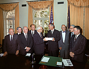 """Author photo. The Warren Commission presents its report to President Johnson. From left to right: John McCloy, J. Lee Rankin (General Counsel), Senator Richard Russell, Congressman Gerald Ford, Chief Justice Earl Warren, President Lyndon B. Johnson, Allen Dulles, Senator John Sherman Cooper, and Congressman Hale Boggs. By Cecil W. Stoughton - White House photo by Cecil Stoughton, via LBJ Library; TIF converted to .jpg, Public Domain, <a href=""""https://commons.wikimedia.org/w/index.php?curid=3530530"""" rel=""""nofollow"""" target=""""_top"""">https://commons.wikimedia.org/w/index.php?curid=3530530</a>"""