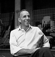 Author photo. Jerome Robbins sitting on chair during rehearsal for West Side Story.<br>  