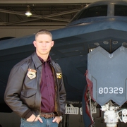Author photo. James R. Hannibal in front of a B-2 Spirit (Stealth Bomber), shot by fellow stealth pilot Brian Anderson