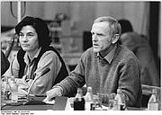 Author photo. Günter de Bruyn (right) with Christa Wolf.  Photo by Gabriele Senft. (Deutsches Bundesarchiv Bild 183-Z1229-317)
