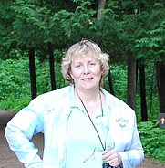 Author photo. I have discovered a new hobby - Geocaching Here I am at Itasca State Park near the headwaters of the Mississippi River in Minnesota.