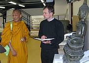 Author photo. Dr. Christian Schicklgruber with a Thai Monk in the depository of the Museum für Völkerkunde in Vienna (May 2008) [picture by John D. Marshall].