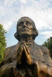 Author photo. Monument to St. John Vianney, Poznań, Poland.  Photo by user Klapi / Wikimedia Commons.