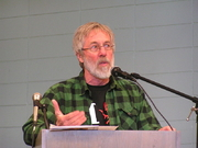 Author photo. John Zerzan discusses The Coming Insurrection during a lecture at the 2010 San Francisco Anarchist Bookfair