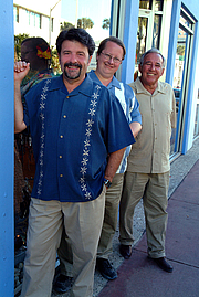 """Author photo. The Three Guys From Miami on the streets in South Beach. (l to r) Jorge Castillo, Glenn Lindgren, and Raul Musibay. By Gmlindgren - Own work, CC BY-SA 3.0, <a href=""""https://commons.wikimedia.org/w/index.php?curid=17083071"""" rel=""""nofollow"""" target=""""_top"""">https://commons.wikimedia.org/w/index.php?curid=17083071</a>"""