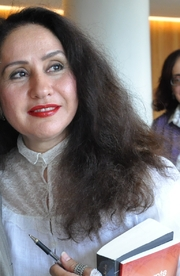 """Author photo. By Peripatetic (Original image) - →This file has been extracted from another file: Mohammed Achaari and Rajaa Alem, joint winners of the 2011 Arabic Booker Prize.jpg, <a href=""""https://commons.wikimedia.org/w/index.php?curid=42769673"""" rel=""""nofollow"""" target=""""_top"""">https://commons.wikimedia.org/w/index.php?curid=42769673</a>"""