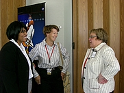 Author photo. Author Martha Ackmann (right) speaks with former astronaut Eileen Collins and Office of Equal Opportunity and Diversity representative Evett Turner at a luncheon during her visit to JSC.