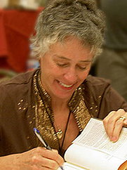 Author photo. Signing books at the 2006 Bouchercon World Mystery Convention in Madison, Wisconsin / Photo by Oldbeeg