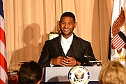 Author photo. By U.S. Department of State from United States - American Artist Usher Delivers Remarks at the 2015 Kennedy Center Honors Dinner in Washington, Public Domain