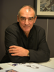 """Author photo. Belgium comics artist Philippe Francq signing his last book in a bookshop, Le Mans, France, november 2014. By Selbymay - Own work, CC BY-SA 4.0, <a href=""""//commons.wikimedia.org/w/index.php?curid=36918190"""" rel=""""nofollow"""" target=""""_top"""">https://commons.wikimedia.org/w/index.php?curid=36918190</a>"""