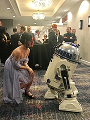 Author photo. Author with R2D2 at 2019 Nebulas. From author's twitter.