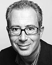 Author photo. Ben Elton