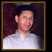 Author photo. Dr. Anjan Chakraverty. Photo from <a href=&quot;http://www.divinecarriers.com/artists.html&quot; rel=&quot;nofollow&quot; target=&quot;_top&quot;><i>Divine Carriers</i></a>.