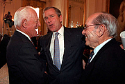 Author photo. President George W. Bush chats with Hall of Famer's Sparky Anderson, left, and Yogi Berra in a ceremony in the East Room of the White House on March 30, 2001.