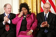 Author photo. Queen of Soul Aretha Franklin wipes a tear after being honored with the Presidential Medal of Freedom Wednesday, Nov. 9, 2005, during ceremonies at the White House. Looking on are fellow recipients Robert Conquest, left, and Alan Greenspan.