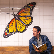 """Author photo. Photo of Peter Kuper, Graphic Artist at the NYC 81st street Subway Station By Hollykuper - Own work, CC BY 3.0, <a href=""""//commons.wikimedia.org/w/index.php?curid=44237067"""" rel=""""nofollow"""" target=""""_top"""">https://commons.wikimedia.org/w/index.php?curid=44237067</a>"""