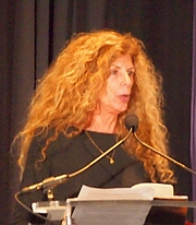 """Author photo. reading at National Book Festival By Slowking4 - Own work, GFDL 1.2, <a href=""""https://commons.wikimedia.org/w/index.php?curid=62180161"""" rel=""""nofollow"""" target=""""_top"""">https://commons.wikimedia.org/w/index.php?curid=62180161</a>"""