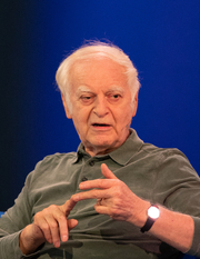 """Author photo. Swiss writer and professor of literature en:Adolf Muschg at the Frankfurt Book Fair 2018. By Ptolusque - Own work, CC BY-SA 4.0, <a href=""""https://commons.wikimedia.org/w/index.php?curid=73914450"""" rel=""""nofollow"""" target=""""_top"""">https://commons.wikimedia.org/w/index.php?curid=73914450</a>"""