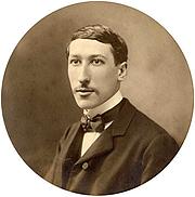 Author photo. A 1925 studio photo portrait of René Guénon (age 38).