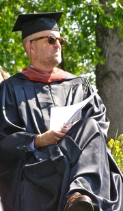 Author photo. Photo by Melinda Stuart. Tony Earley, on the stage at Warren Wison College (WWC) Commencement, 2010, just before delivering the invited Address. Earley is a WWC alumnus.