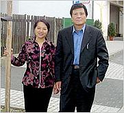 Author photo. Chen Guidi (right)/NYT