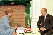 Author photo. Wikipedia, President Vladimir Putin with Permanent Secretary of the French Academy Helene Carrere d'Encausse
