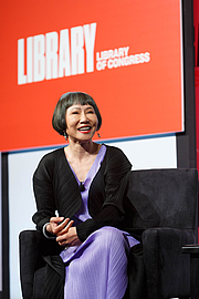 """Author photo. Amy Tan speaks with National Book Festival Literary Director Marie Arana on the Main Stage, September 1, 2018. Photo by Shawn Miller/Library of Congress. By Library of Congress Life - 20180901SM1138.jpg, CC0, <a href=""""https://commons.wikimedia.org/w/index.php?curid=83102549"""" rel=""""nofollow"""" target=""""_top"""">https://commons.wikimedia.org/w/index.php?curid=83102549</a>"""