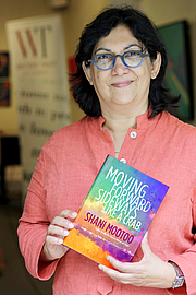 """Author photo. Mootoo with her book, Moving Forward Sideways Like a Crab By Kaparica - Own work, CC BY 4.0, <a href=""""https://commons.wikimedia.org/w/index.php?curid=87515569"""" rel=""""nofollow"""" target=""""_top"""">https://commons.wikimedia.org/w/index.php?curid=87515569</a>"""